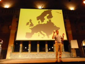 Ray Algar speaking at the IHRSA European Congress in Amsterdam. Slide shows large map of Europe