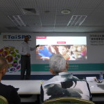 Ray Algar pointing at a slide of the Fitness First brand during his TaiSPO 2016 talk in Taiwan