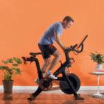 John Foley – CEO Peloton riding one of their bikes