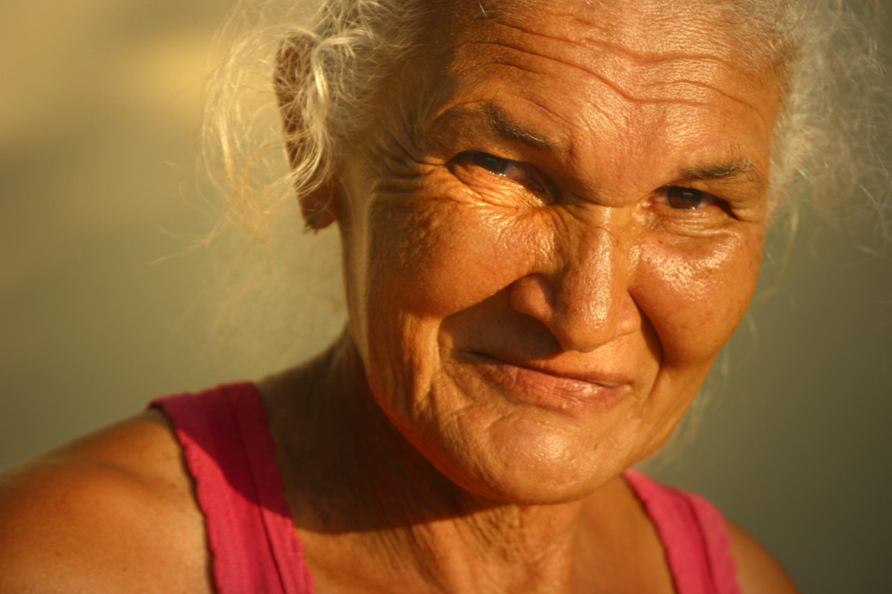 A healthy-looking older woman who is smiling towards the camera